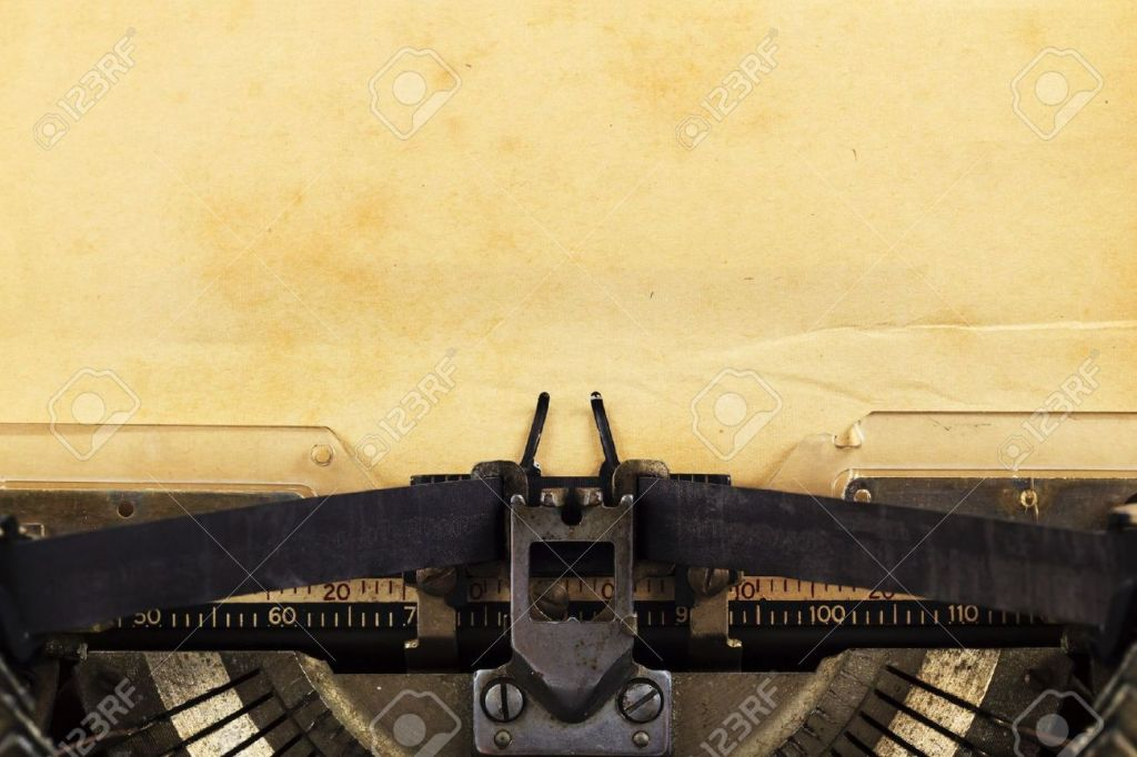old-typewriter-with-paper-Stock-Photo